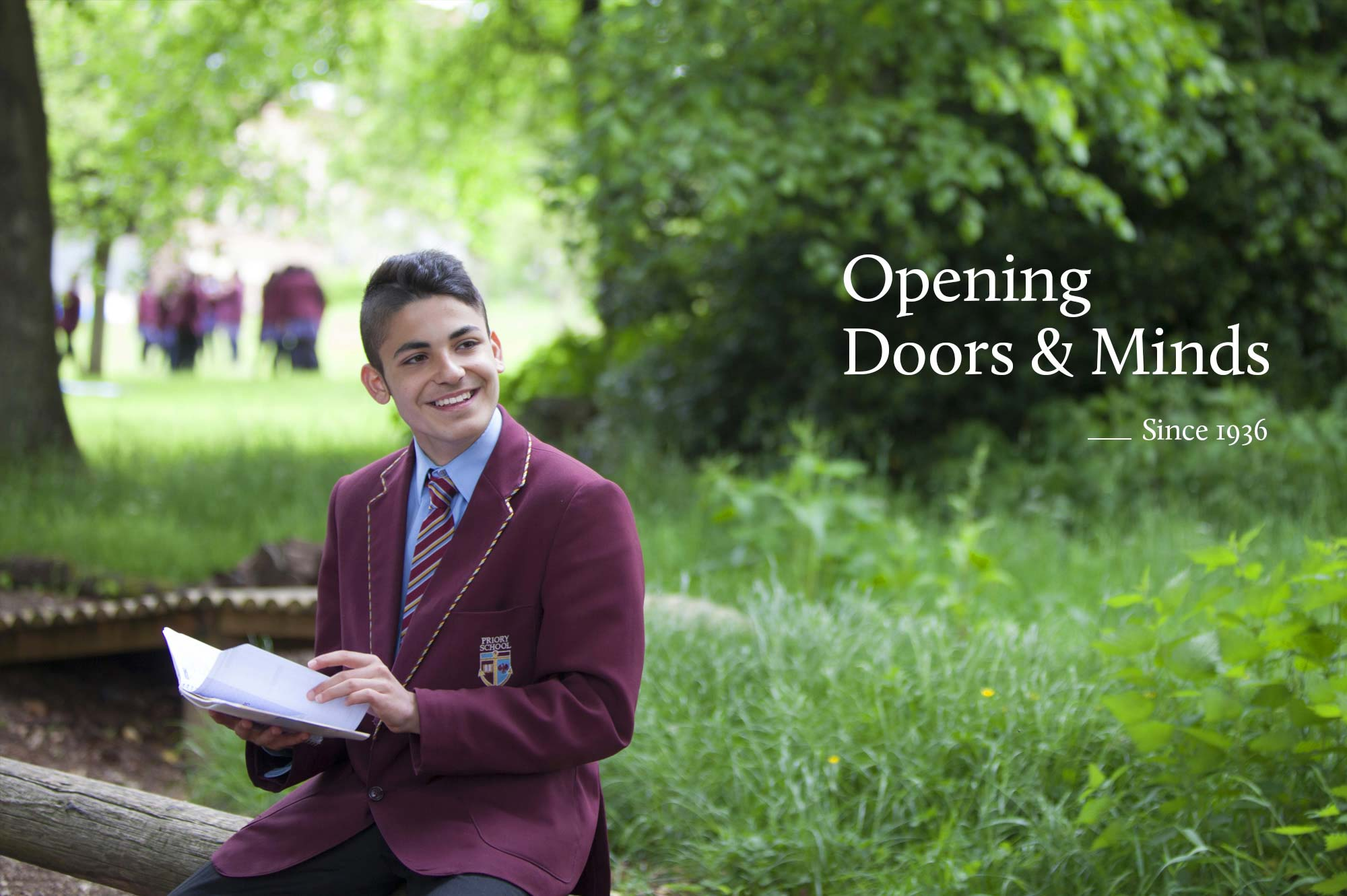 Priory School pupil sitting outside reading