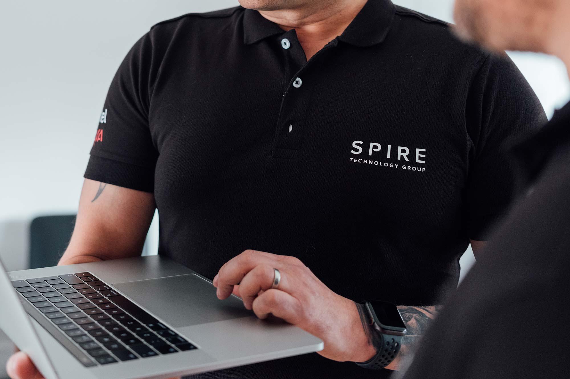 IT professional holding laptop