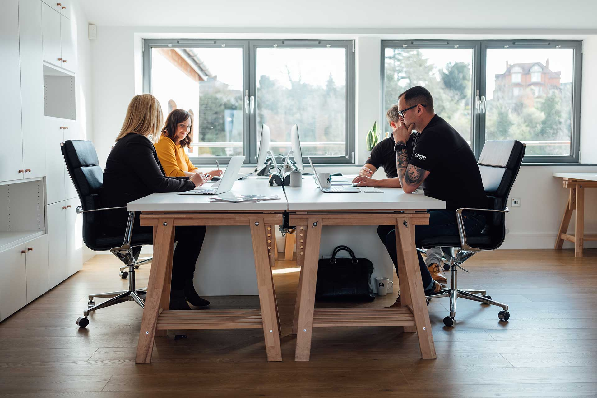 Spire Technology Group working in office